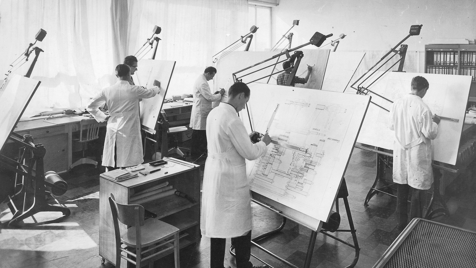 Students at Bosch Packaging drawing plans in black and white