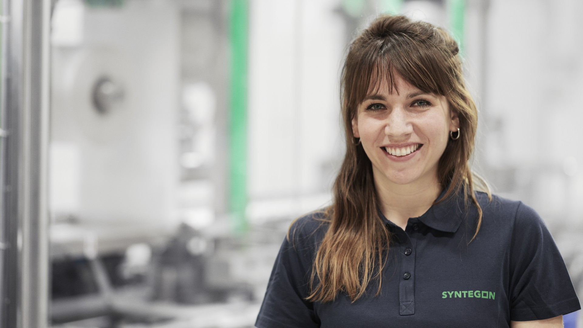 Young Syntegon employee smiling